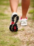 15353611-closeup-of-female-legs-jogging-on-a-trail